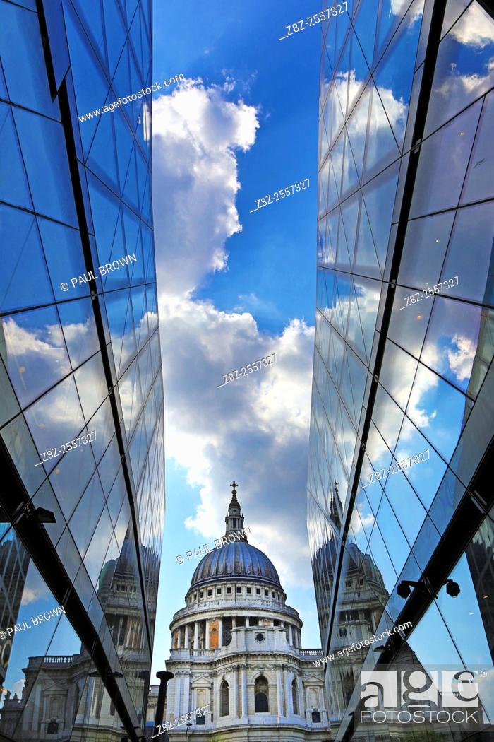Stock Photo: St Paul's Cathedral and reflection of clouds in glass of One New Change, London, England.
