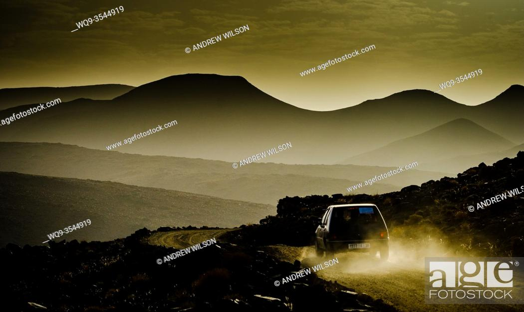 Stock Photo: Early morning mountain view from the Tizi N'Tazezert trail (piste) in southern Morocco as a car makes it's way along the trail.