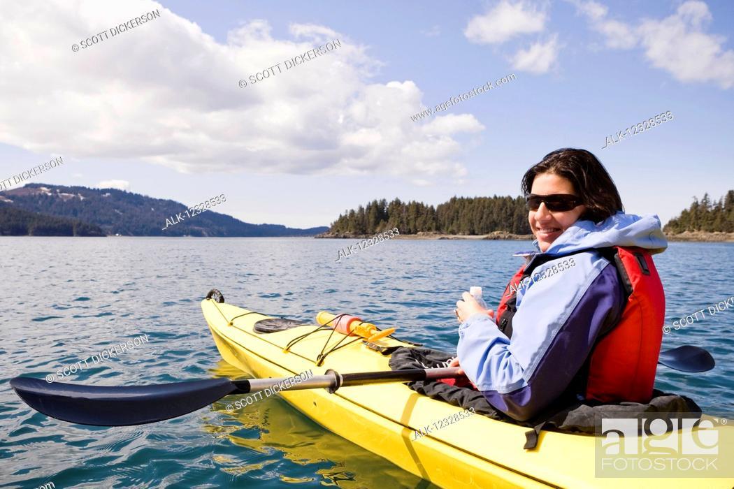 Stock Photo: Woman sea kayaking in Kachemak Bay, near Homer, South-central Alaska; Alaska, United States of America.