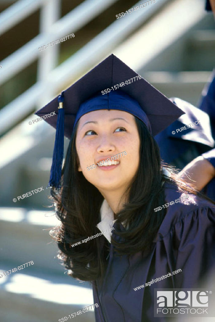 Stock Photo: Young female graduate smiling.