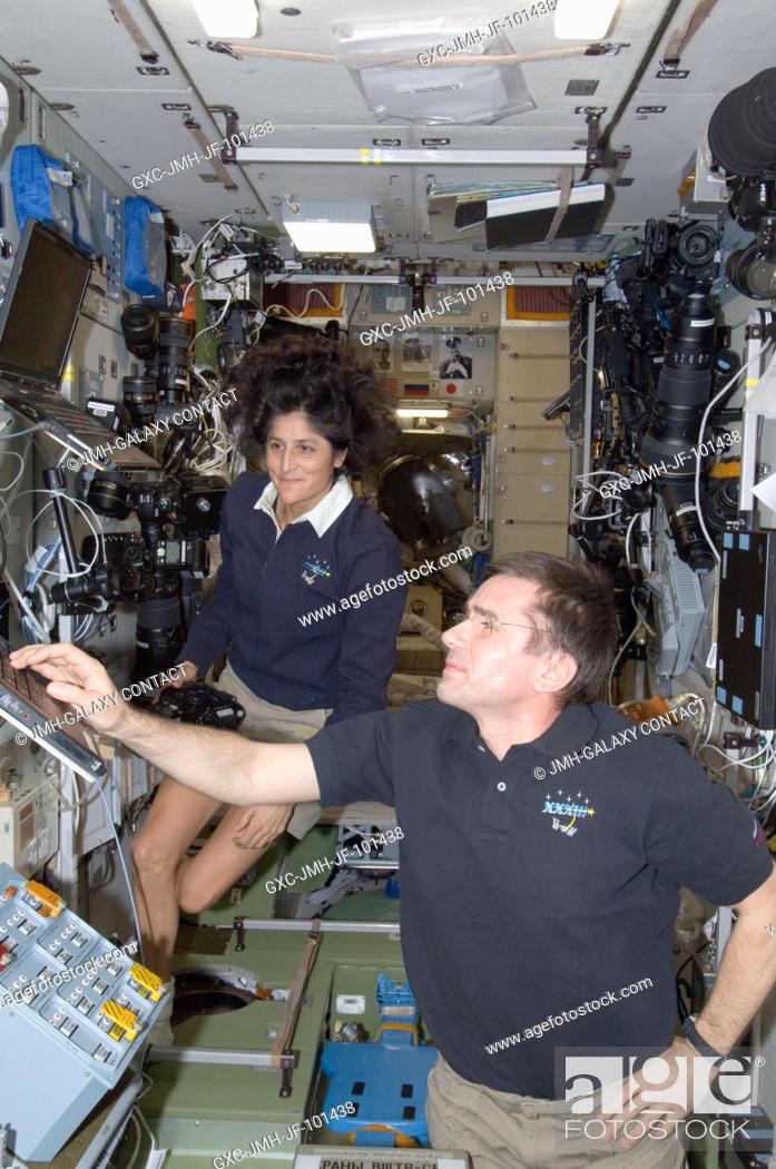 Stock Photo: NASA astronaut Sunita Williams, Expedition 33 commander; and Russian cosmonaut Yuri Malenchenko, flight engineer, work in the Zvezda Service Module of the.