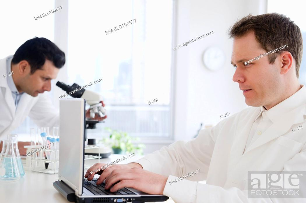 Stock Photo: Scientists working in laboratory.