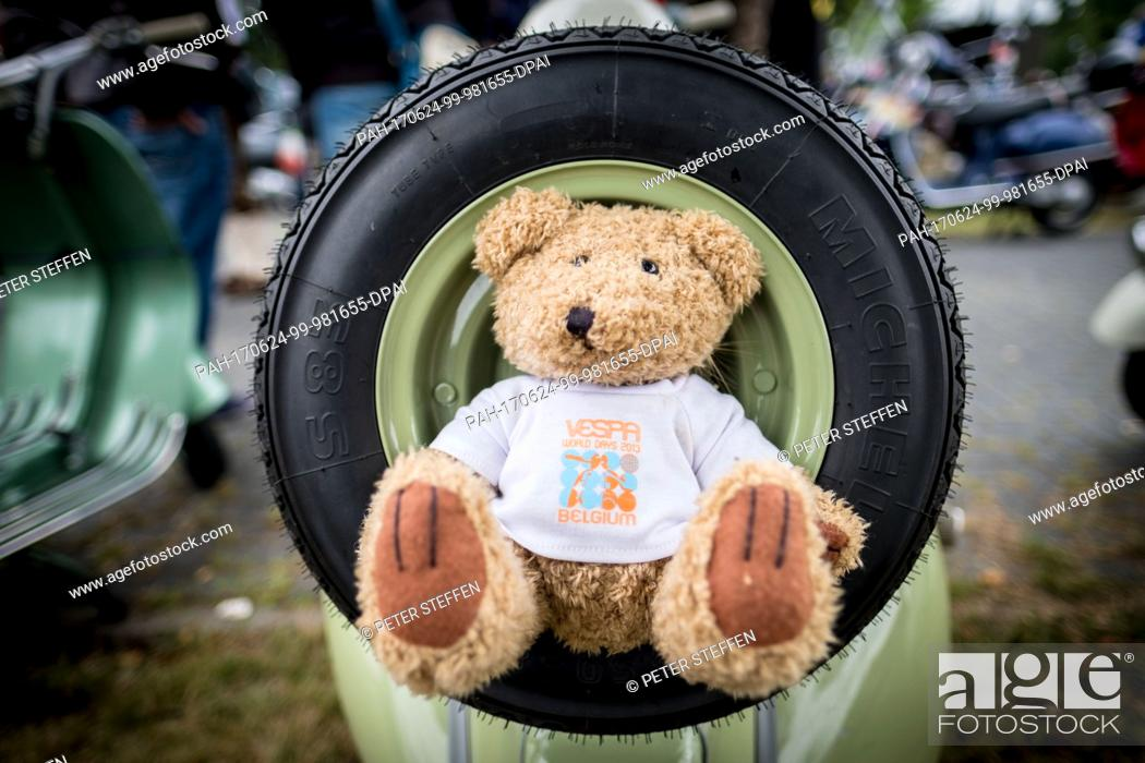 b6bbeaf94eb61c Stock Photo - A stuffed bear with a Vespa t--shirt sits on a spare tyre  Military at the so-called Vespa Village during the Vespa World Days 2017 in  Celle