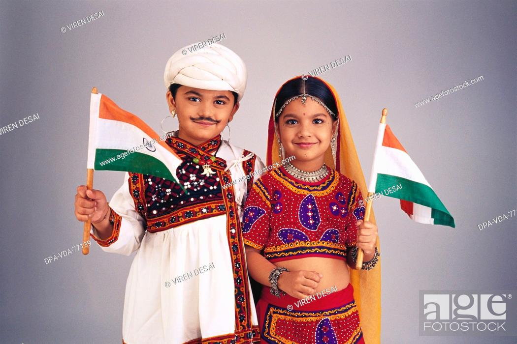 089324cc6 Stock Photo - Children dressed as Gujarati Couple ; boy and girl Wearing  Traditional Rural costume ; Holding The Indian Flags MR 498(Boy) ; MR  497(Girl)