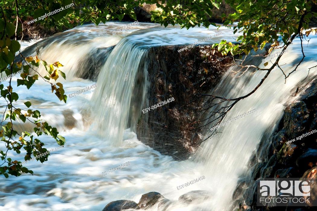 Stock Photo: Beautiful cascading waterfall over rocks.