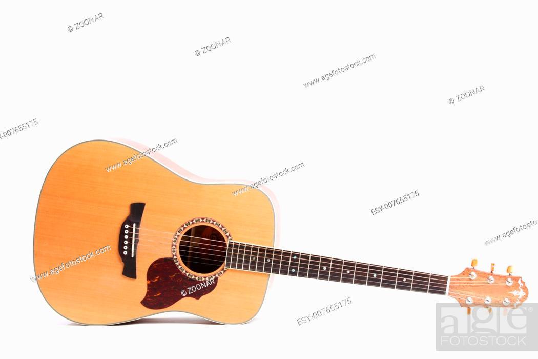 Stock Photo: guitar isolated on white background.