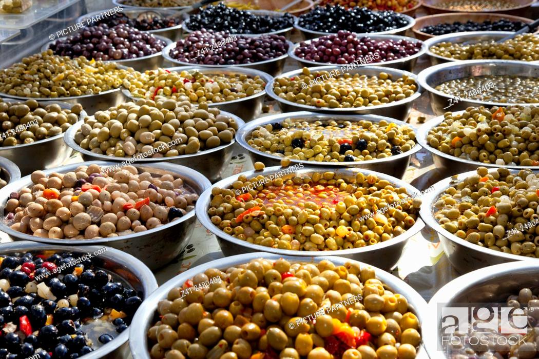 Stock Photo: Variety of black and green olives in bowls on the market.
