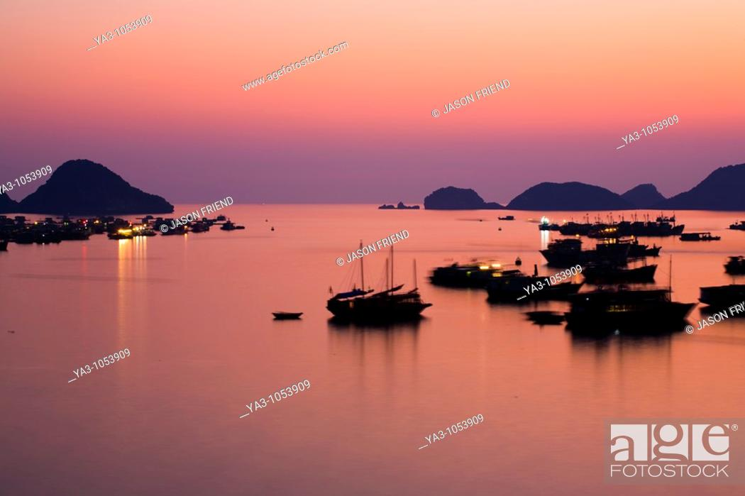 Stock Photo: Vietnam, Northern Vietnam, Halong Bay  The pink sunset afterglow at dusk over Cat Ba harbour on Cat Ba Island.
