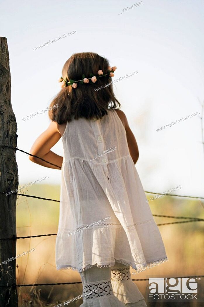 Stock Photo: girl, countryside, back view, looking.