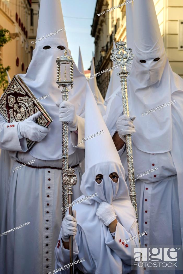 Stock Photo: Trio of Nazarene penitents participating in a procession during Easter.