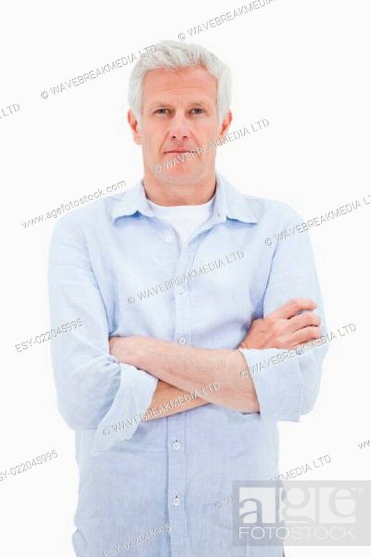 Stock Photo: Portrait of a mature man with the arms crossed.