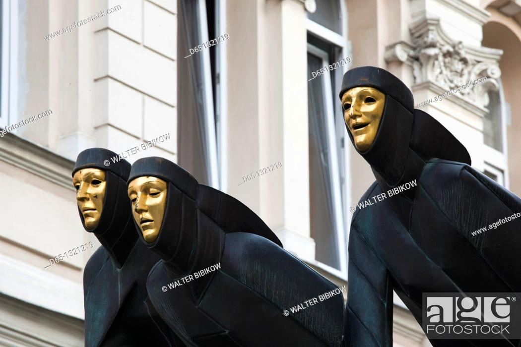Stock Photo: Lithuania, Vilnius, Three Muses sculpture atop Lithuanian National Drama Theater.