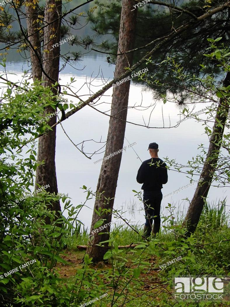 Stock Photo: Adult Male Fishing in Lake, Allegany State Park, Salamanca, New York, USA.