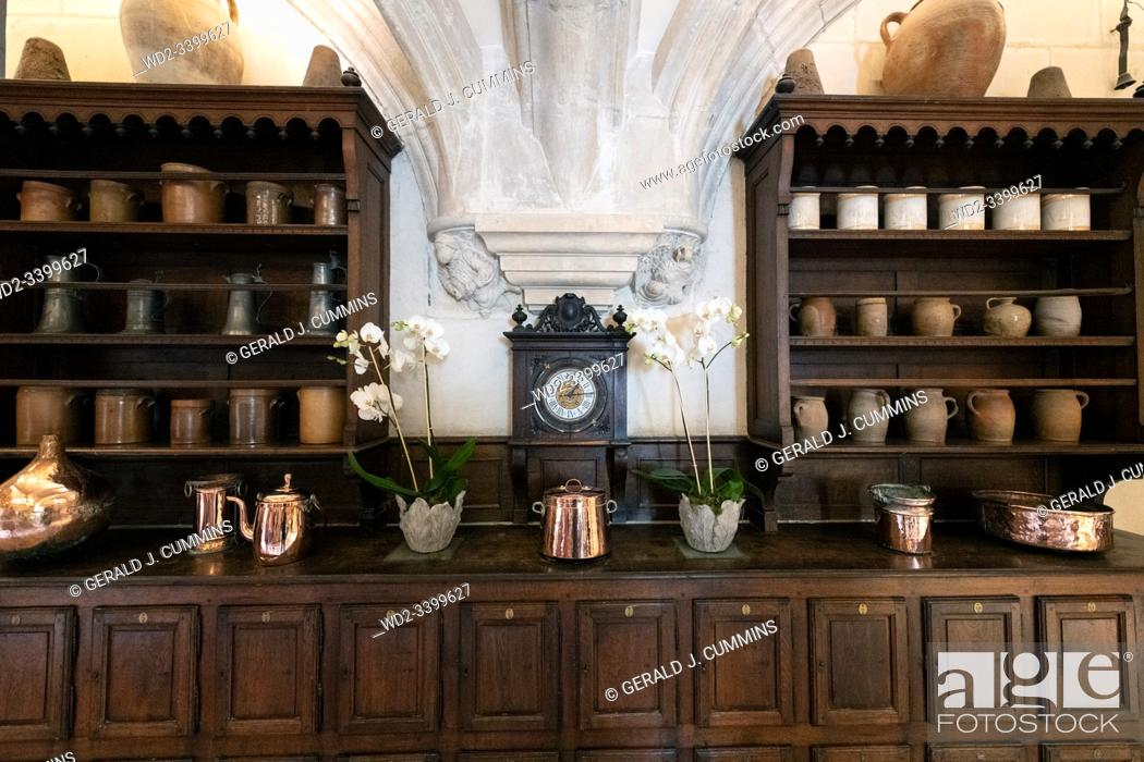 Stock Photo: Europe France Chenonceaux : 2019-07 Wooden buffee in the castle of Chenonceauâ. . s kitchen. Complete with shiny brass and copper items.