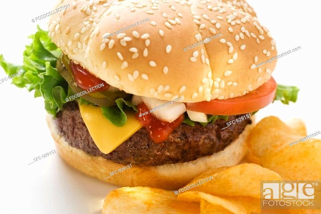 Stock Photo: Cheeseburger with potato crisps.