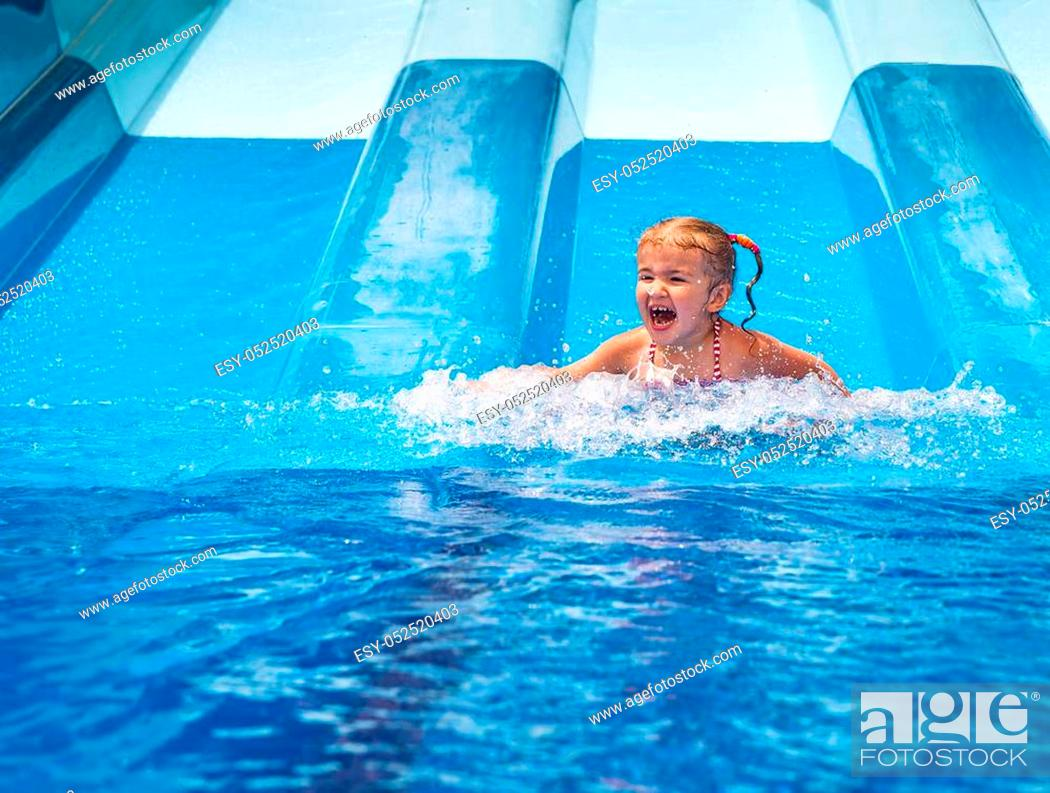Stock Photo: Dad teaches a little daughter to swim in the pool. Aquapark.