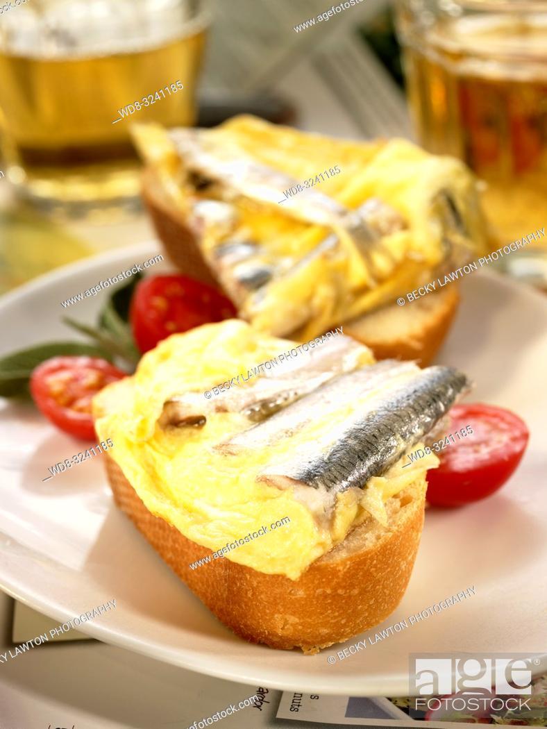 Stock Photo: montadito de tortilla de boquerones y guindilla.