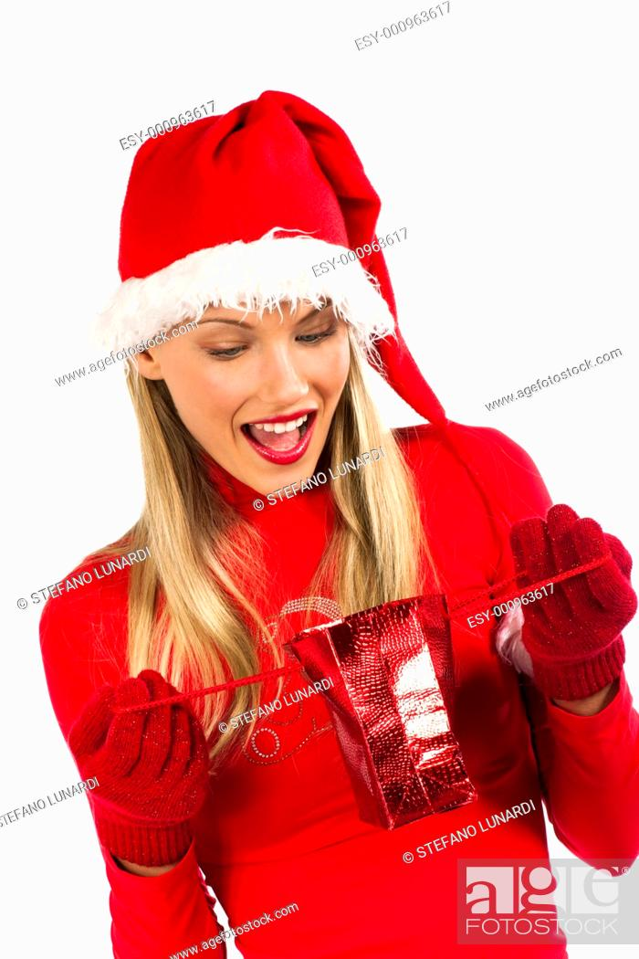 Stock Photo: Rich, colorful series of attractive young woman in santa's hat with presents.