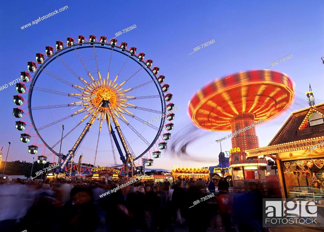 Stock Photo: Ferris wheel and swing carousel, Oktoberfest (Octoberfest Munich Beer Festival), Munich, Germany.