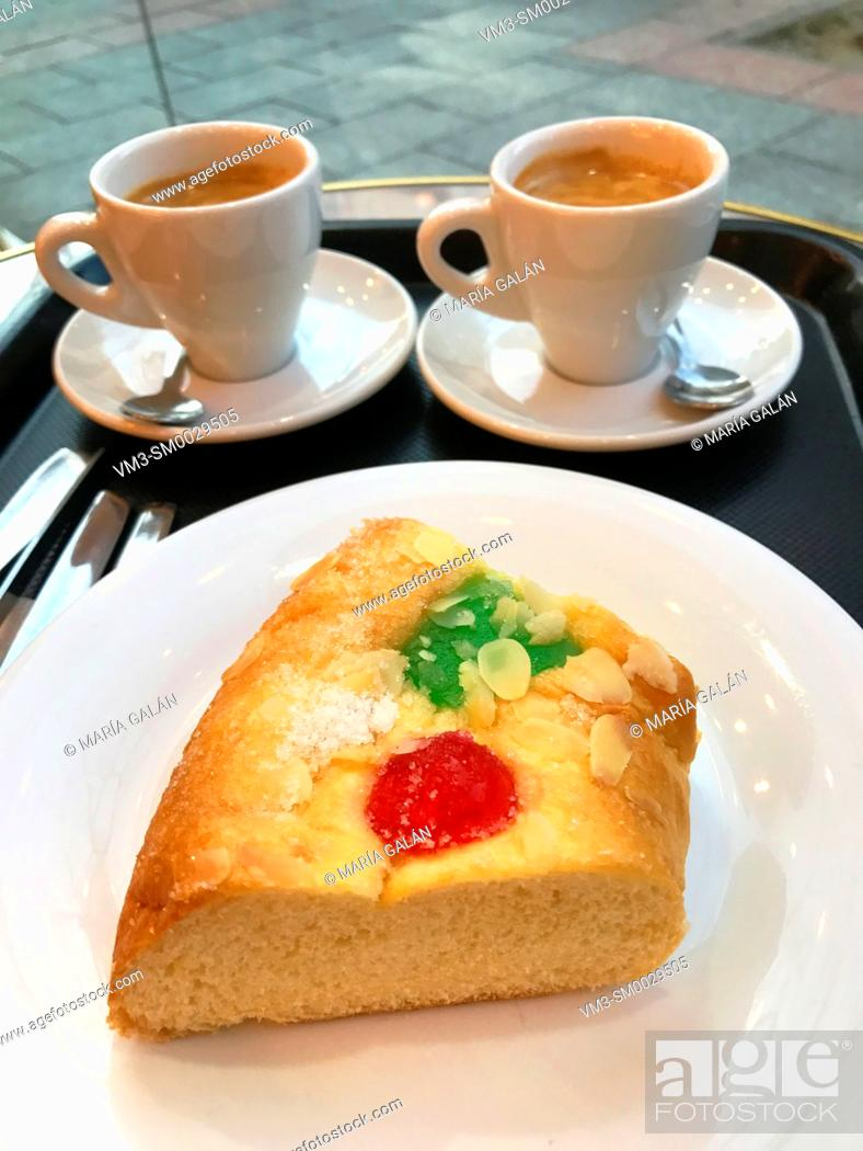 Stock Photo: Roscon de Reyes serving and two cups of coffee. Spain.