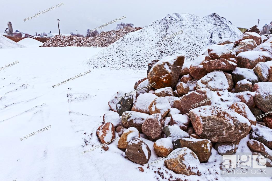 Stock Photo: Rock and stone piles at a local road construction company in the winter. Ludington, Michigan, USA.