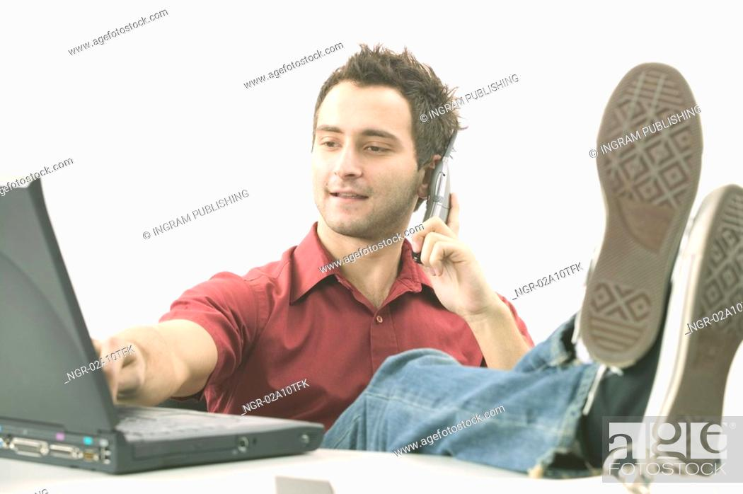 Stock Photo: Relaxed Man in Red Shirt with Laptop.