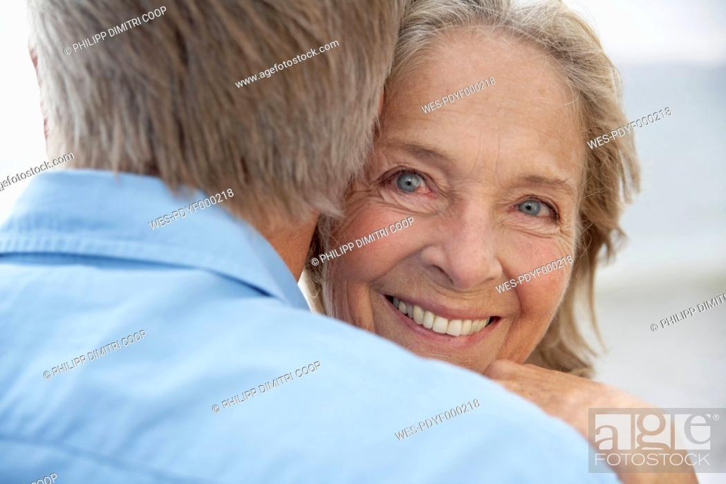 Stock Photo: Spain, Senior couple embracing each other, smiling.