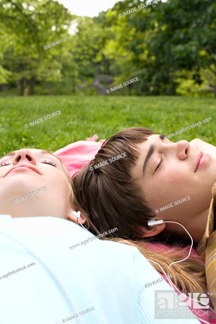 Stock Photo: Teenagers listening to an mp3 player.