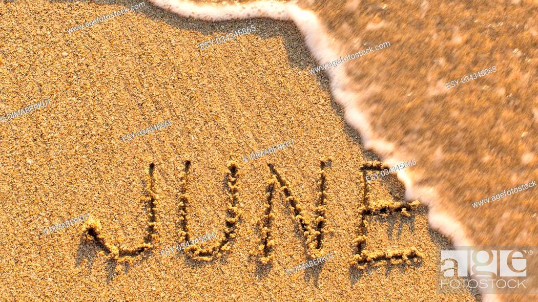 Stock Photo: Inscription JUNE on a gentle beach sand with the soft wave (months of the year series).