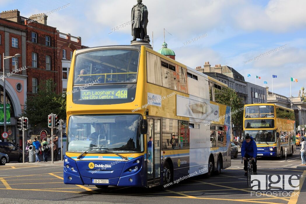 Stock Photo: O'Connell Street, Dublin, County Dublin, Republic of Ireland, Eire, Europe  Double decker buses passing the Daniel O'Connell Monument.