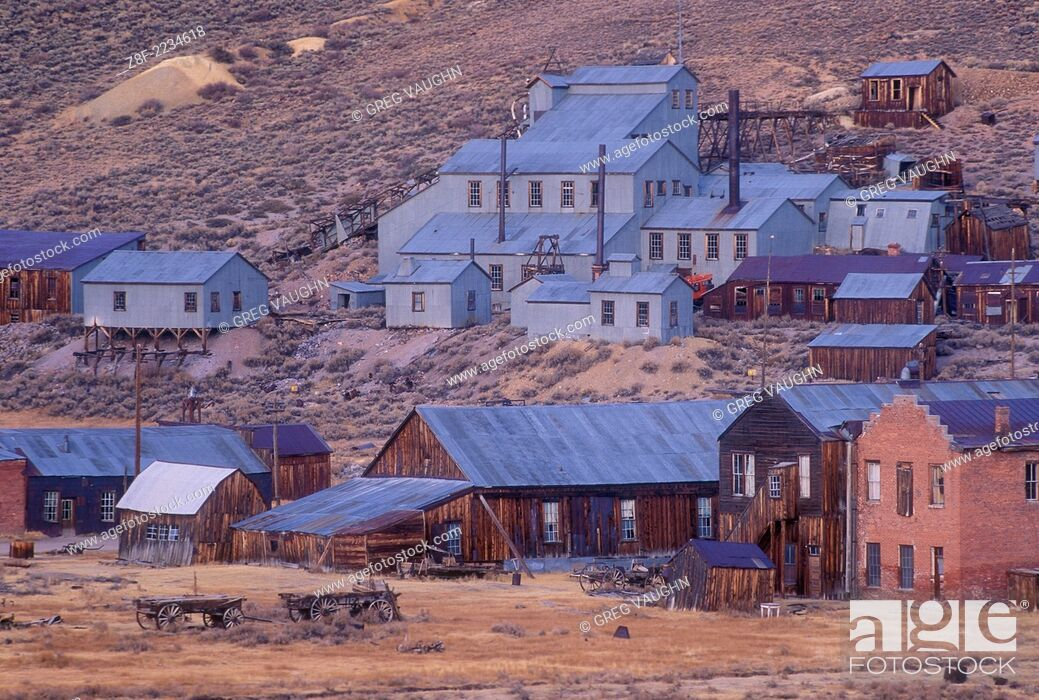 Stock Photo: Bodie ghost town at dusk with old Standard Stamp Mill buildings on hillside; Bodie State Historical Park, California.
