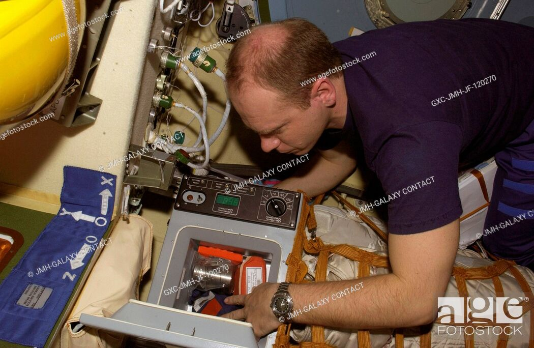 Stock Photo: Cosmonaut Oleg V. Kotov, Expedition 15 flight engineer representing Russia's Federal Space Agency, works with a Cryogem-03 refrigerator in the Zvezda Service.