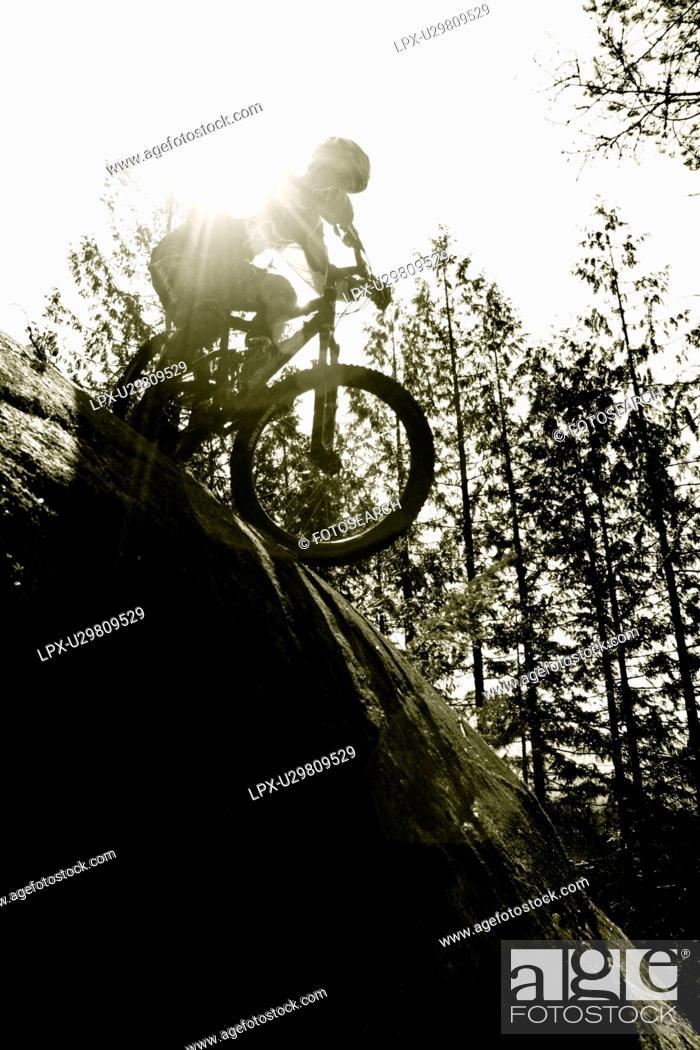 Stock Photo: moutain biking extreme riding in British Columbia.