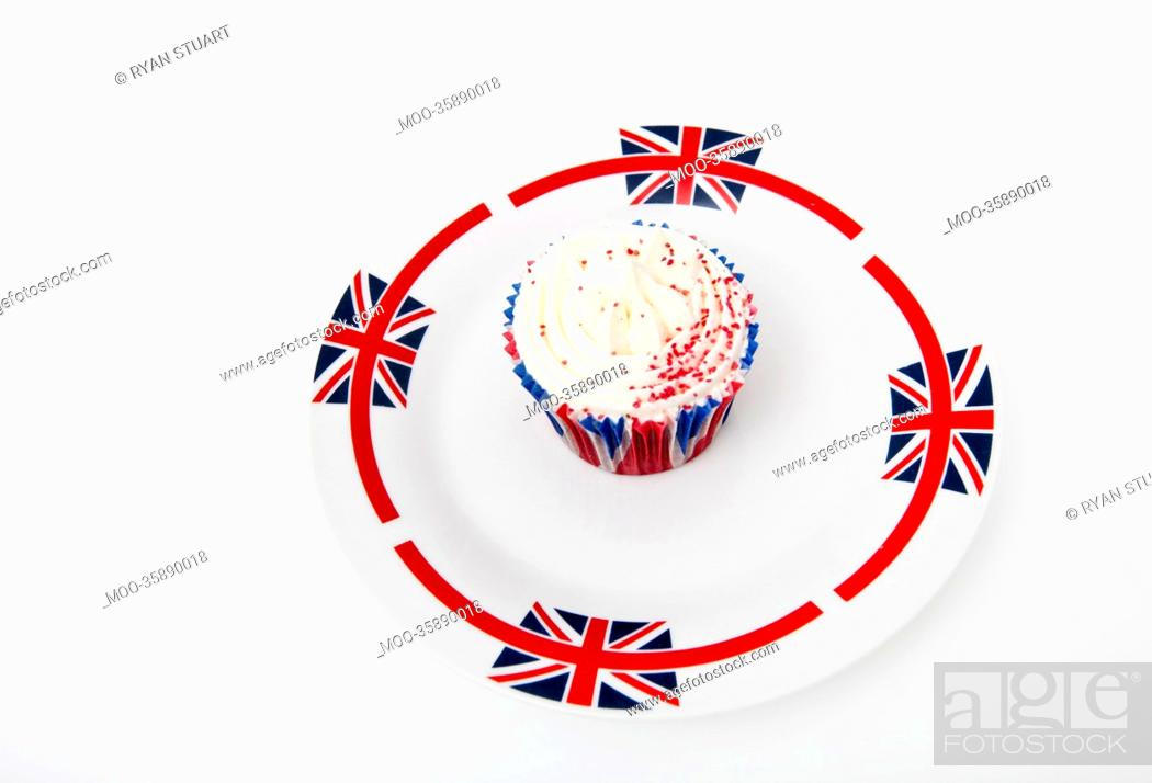 Stock Photo: Cupcake in Union Jack plate against white background.