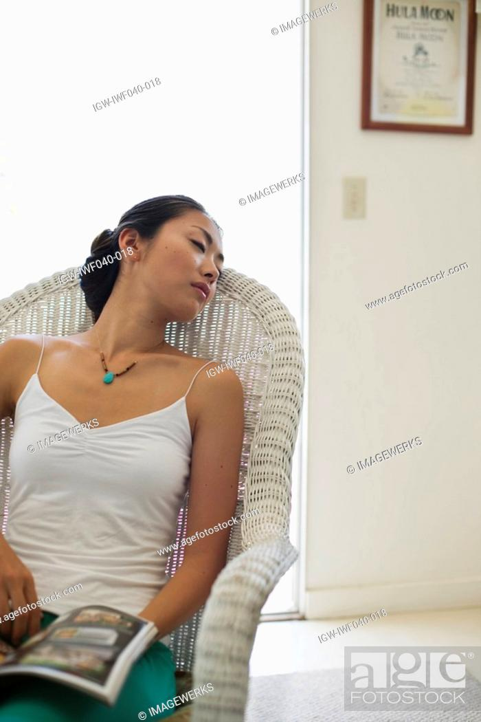 Stock Photo: A young woman sleeping on chair.