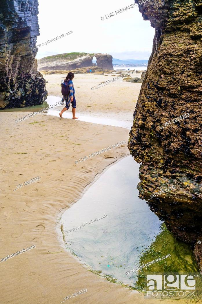 Imagen: Female solo traveler at Beach of the Cathedrals Natural Monument at Ribadeo municipality, Lugo province, Galicia, Spain, Europe.