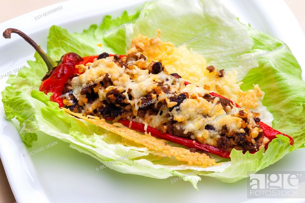 Stock Photo: baked pepper baked filled with beans, mushrooms and minced meat.