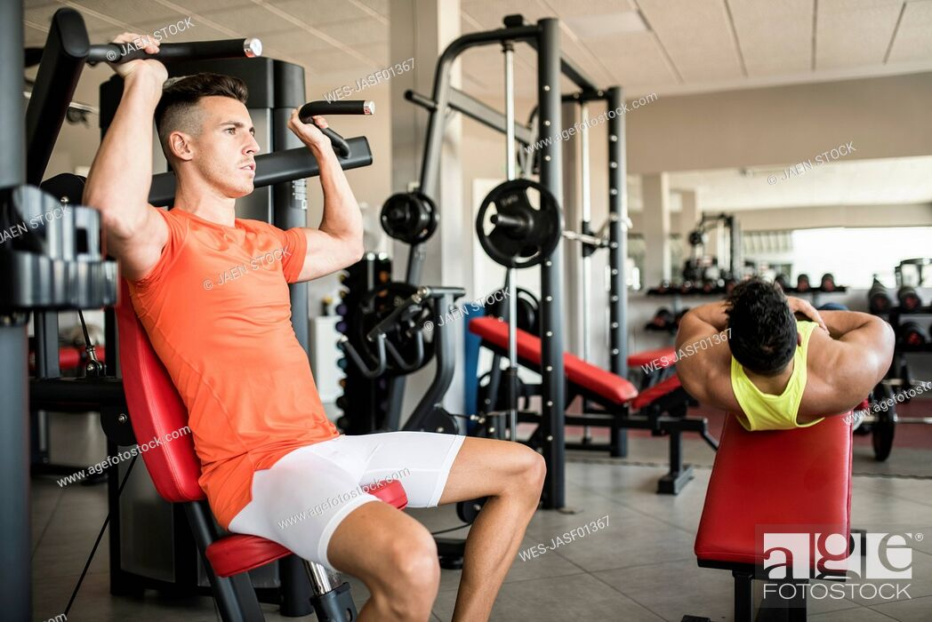 Stock Photo: Two men exercising in gym.