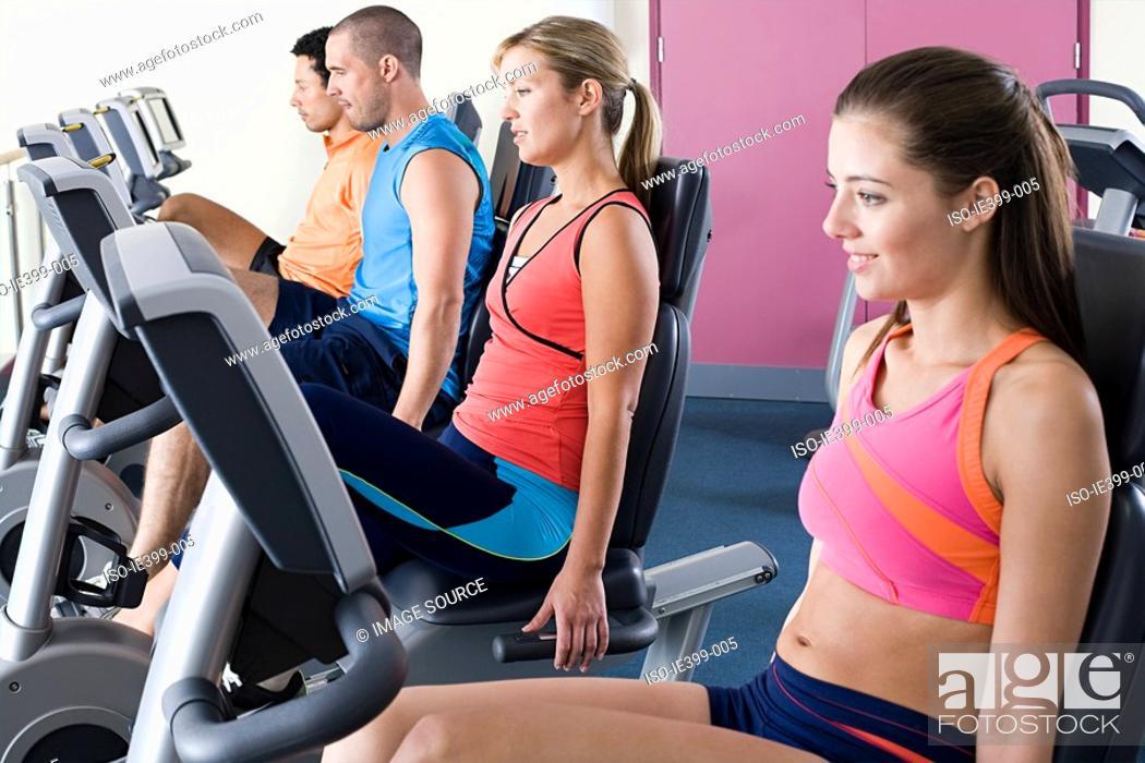 Stock Photo: People on exercise bikes.