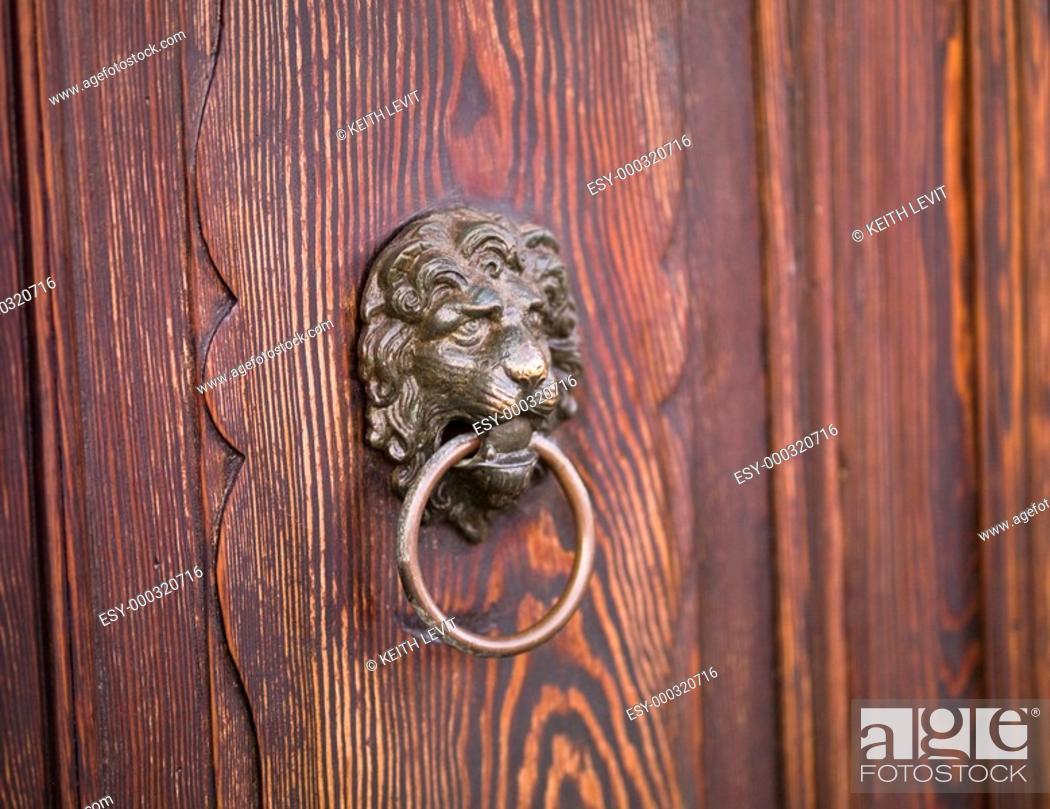 Stock Photo: Lion door knocker.