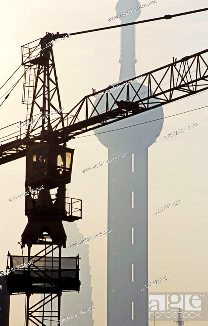 Stock Photo: Construction crane and Oriental Pearl Tower. Shanghai. China.