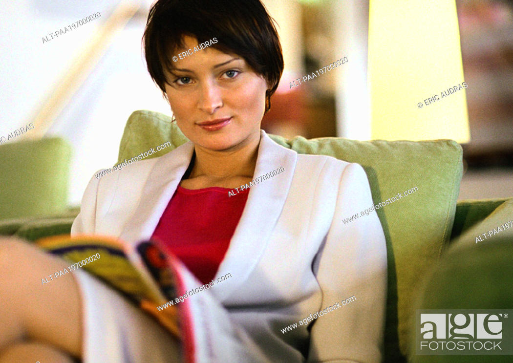 Stock Photo: Businesswoman sitting looking at camera, portrait.