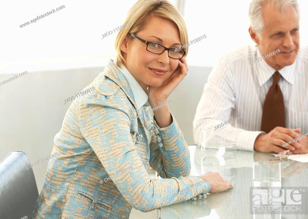 Stock Photo: Portrait of confident businesswoman in meeting room.