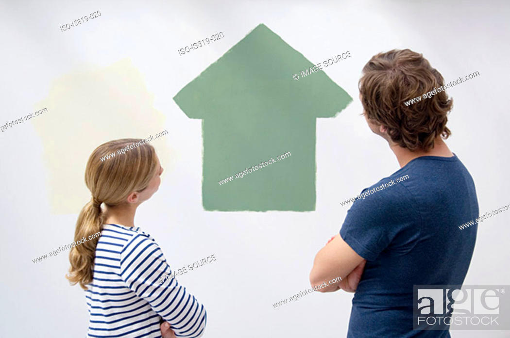 Stock Photo: Couple looking at a painted house.