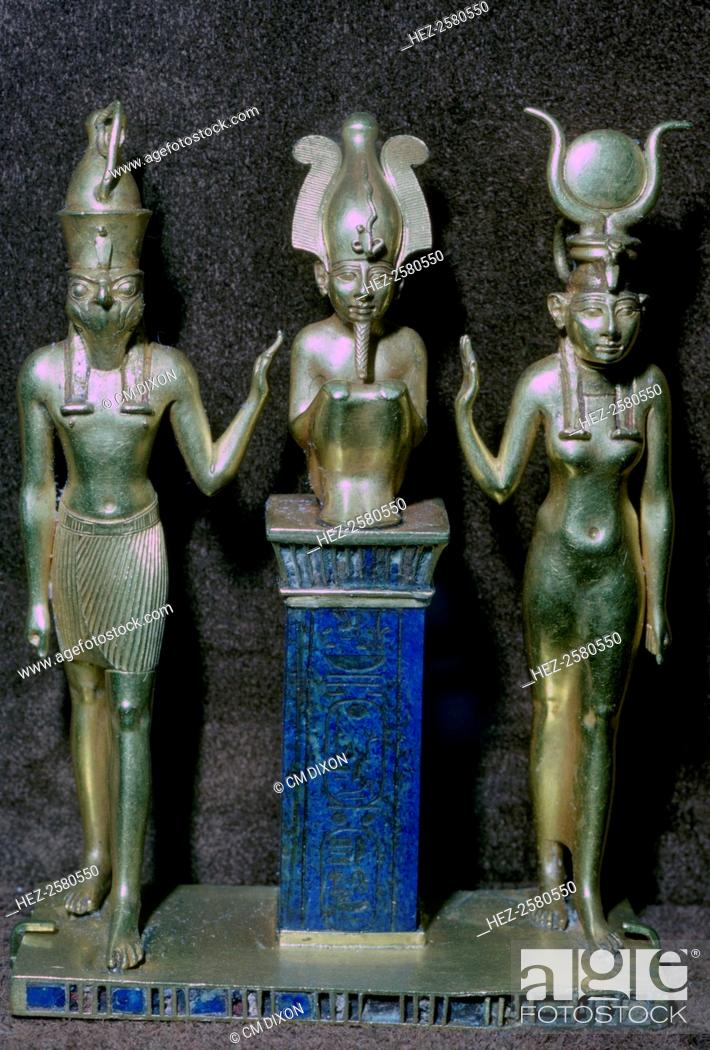 Stock Photo: Gold statuettes of Osiris, Horus, and Isis, from the jewellery of King Orsokon, from the Louvre's collection.