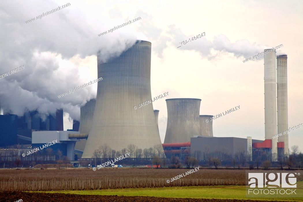 Stock Photo: Smokestacks from a power plant spew toxic smoke into the atmosphere.