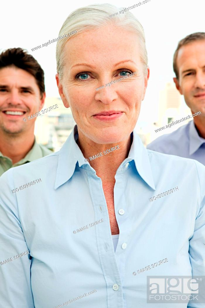 Stock Photo: Three businesspeople, focus on woman.