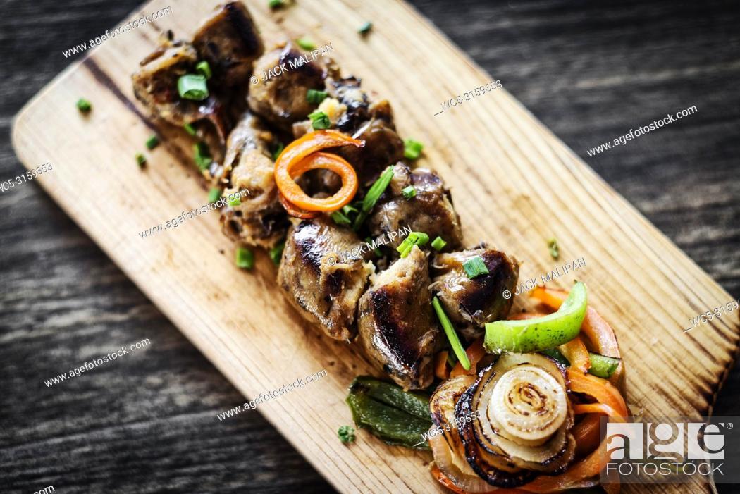 Photo de stock: grilled fresh portuguese chourico chorizo sausage starter tapas snack set on wood board.