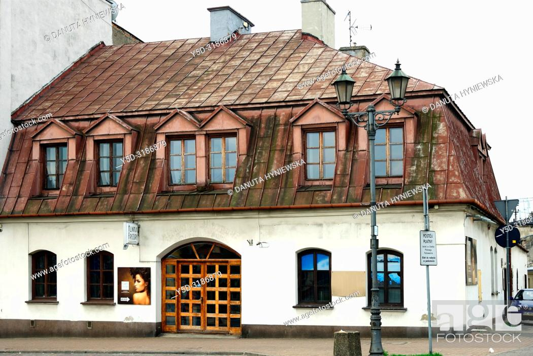 Stock Photo: Historic inn, Old market square in old town of Czestochowa, many old conservation buildings rebuilt and maintained by the authorities and private sector.