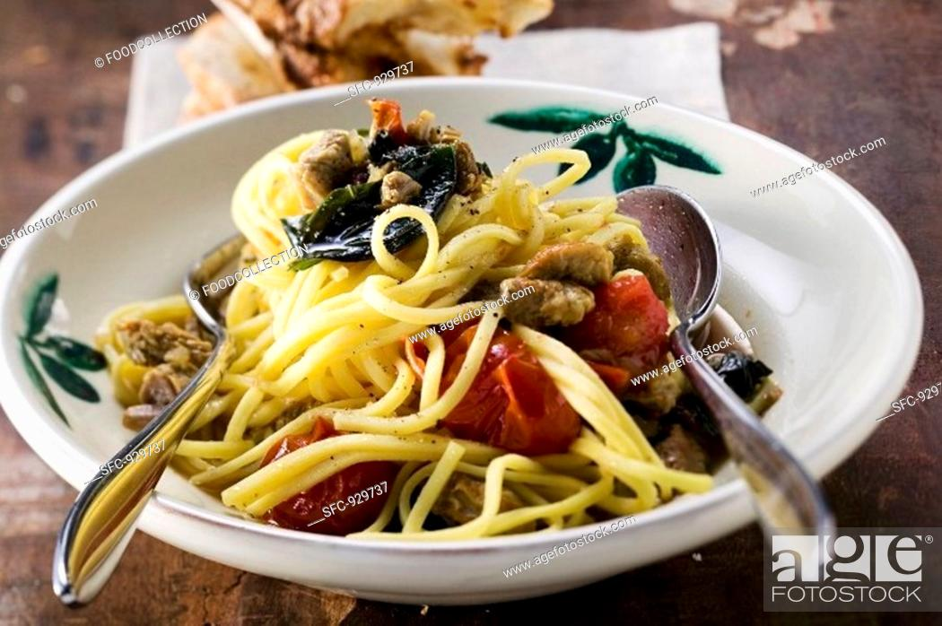 Stock Photo: Linguine with veal and cherry tomatoes.
